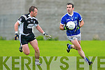 5821 - not using.----.Cool hand.---------.Kerin's O'Rahilly's Declan Quill(no 13)catches the ball ahead of John O'Connor(no 11)as Niall Clifford(Ardfert)and Kieran O'Mahony scramble on the grass.