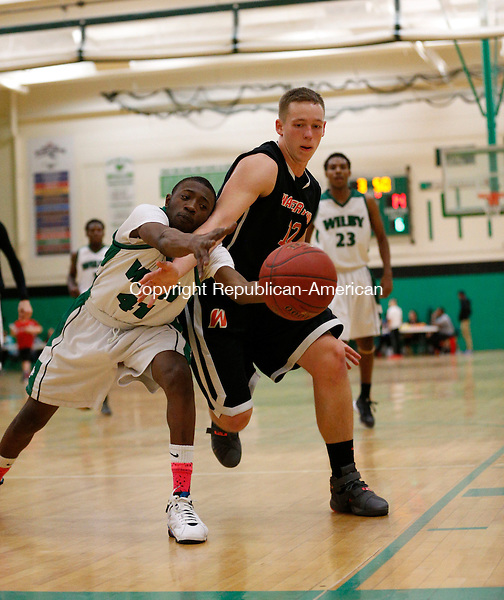 Waterbury, CT- 07 January 2016-010716CM08- Wilby's Ezra Goodman, left, and Watertown's Zach Kopp go after the ball during their NVL matchup in Waterbury on Thursday.     Christopher Massa Republican-American