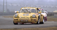 The #55 Porsche 911 Carerra RSR of Enzo Calderari, Ferdinand de Lesseps, Lilian Bryner, and Ulli Richter races to a 4th place finish in the 24 Hours of Daytona, IMSA race, Daytona International Speedway, Daytona Beach , FL, February 4, 1996.  (Photo by Brian Cleary/www.bcpix.com)