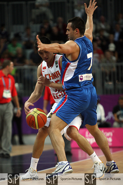 Bo Zhang (China) and Ivan Paunic (Serbia) in action. Serbia v China.  The London International Basketball Invitational. London Prepares for Olympics 2012. Basketball Arena, Olympic Park. London. 17/08/2011. MANDATORY Credit Sportinpictures/Paul Chesterton - NO UNAUTHORISED USE - 07837 394578.