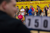 Saniaya Fu waits for her score to be announced after her routine during the 3rd International Chan Wu, Traditional Kung Fu and Wu Shu Championships in Budapest, Hungary on November 24, 2012. ATTILA VOLGYI