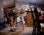 Evie, 2, and her father. Adger, Birmingham, Alabama.