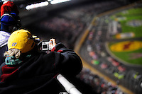 Oct. 17, 2009; Concord, NC, USA; A NASCAR Sprint Cup Series fan takes a picture during the NASCAR Banking 500 at Lowes Motor Speedway. Mandatory Credit: Mark J. Rebilas-