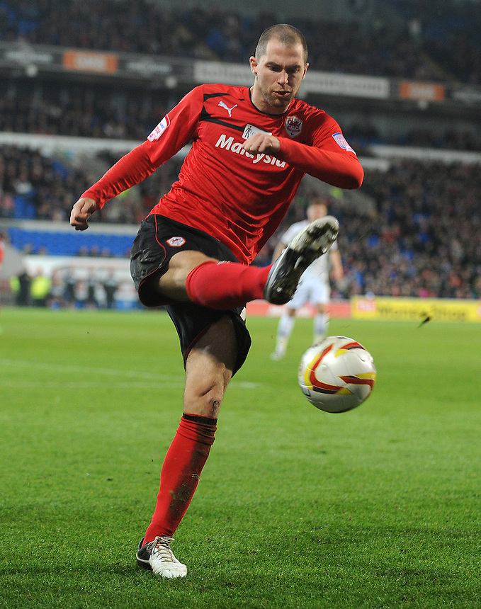 Cardiff City's Matthew Connolly miss kicks the ball..Football - npower Football League Championship - Cardiff City v Derby County - Tuesday 05th March 2013 - Cardiff City Stadium - Cardiff..© CameraSport - 43 Linden Ave. Countesthorpe. Leicester. England. LE8 5PG - Tel: +44 (0) 116 277 4147 - admin@camerasport.com - www.camerasport.com
