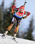 Biathletes compete during the women relay race of the biathlon World Cup on December 13, 2014 in Hochfilzen, Austria.
