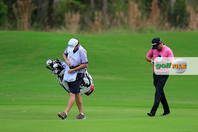 Graeme McDowell (NIR) walking down the 3rd fairway in his stockings during round 4 of the Hero World Challenge, Isleworth Golf &amp; Country Club, Windermere, Orlando Florida, USA. 07/12/2014<br /> Picture Fran Caffrey, www.golffile.ie