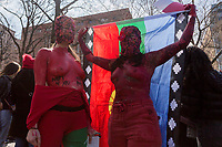 NEW YORK, NEW YORK - MARCH 8:  Two women painted red perform as a protest during the women's strike in Washington Sq Park for Women's Day on March 8, 2020. in New York. 3,500 women were killed for gender reasons in 25 countries in Latin America and the Caribbean in 2019. UN said. (Photo by Pablo Monsalve / VIEWpress via Getty Images)