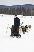 Lachlan Clarke turns on his sled as he runs on the trail on the Kuskokwim river shortly before McGrath on Wednesday during Iditarod 2008