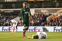 Ben Davies of Tottenham Hotspur (right) lays injured on the floor after a clash with Hugo Lloris of Tottenham Hotspur (2nd right) during the UEFA Europa League match between Tottenham Hotspur and Borussia Dortmund at White Hart Lane, London, England on 17 March 2016. Photo by David Horn / PRiME Media Images