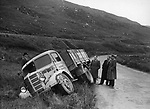 An overturned Kerry County Council truck attracts attention from locals near Molls Gap, Killarney in the 1960's..Photo:-macmonagle.com archive