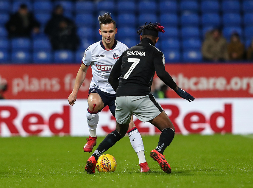 Bolton Wanderers' Pawel Olkowski competing with Reading's Leandro Bacuna  <br /> <br /> Photographer Andrew Kearns/CameraSport<br /> <br /> The EFL Sky Bet Championship - Bolton Wanderers v Reading - Tuesday 29th January 2019 - University of Bolton Stadium - Bolton<br /> <br /> World Copyright © 2019 CameraSport. All rights reserved. 43 Linden Ave. Countesthorpe. Leicester. England. LE8 5PG - Tel: +44 (0) 116 277 4147 - admin@camerasport.com - www.camerasport.com