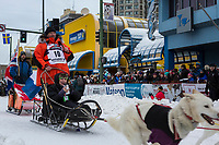 Rob Cooke and team leave the ceremonial start line with an Iditarider and handler at 4th Avenue and D street in downtown Anchorage, Alaska on Saturday March 3rd during the 2018 Iditarod race. Photo ©2018 by Brendan Smith/SchultzPhoto.com