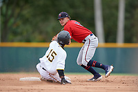 GCL Twins shortstop Keoni Cavaco (9) attempts to turn a double play as Edgar Barrios (15) sidles into second base during a Gulf Coast League game against the GCL Pirates on August 6, 2019 at Pirate City in Bradenton, Florida.  GCL Twins defeated the GCL Pirates 1-0 in the second game of a doubleheader.  (Mike Janes/Four Seam Images)