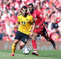 Wolverhampton Wanderers' Jonathan Castro Otto under pressure from Liverpool's Georginio Wijnaldum<br /> <br /> Photographer Rich Linley/CameraSport<br /> <br /> The Premier League - Liverpool v Wolverhampton Wanderers - Sunday 12th May 2019 - Anfield - Liverpool<br /> <br /> World Copyright © 2019 CameraSport. All rights reserved. 43 Linden Ave. Countesthorpe. Leicester. England. LE8 5PG - Tel: +44 (0) 116 277 4147 - admin@camerasport.com - www.camerasport.com
