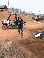 NWA Democrat-Gazette/FLIP PUTTHOFF <br /> BIKE PARK FIX-UP<br /> Ted Huie (cq), maintenance supervisor at the Railyard bicycle park in downtown Rogers, smooths a ramp Tuesday March 19 2019 during repair work at the park. The kids zone at the Railyard is open, but the rest of the park is closed until further notice to repair damage from freezing and thawing of the ground and from storms, Huie said.