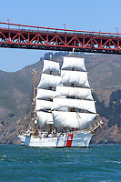 """The USCG Training Barque """"Eagle"""" sails under the Golden Gate Bridge while leading the Parade of Ships during the 2008 San Francisco Festival of Sail. The 295' Training Barque Eagle was originally constructed  in 1936 at the Blohm and Voss Shipyards in Germany with the purpose of training U-Boat crews. The United States took possession of the vessel in 1946 as part of Germany's reparations for the war and it is currently used by the Coast Gaurd for training of United States Coast Guard Academy Cadets. The Eagle is the only active commissioned sailing vessel in the United States' government service. Photographed 07/08"""
