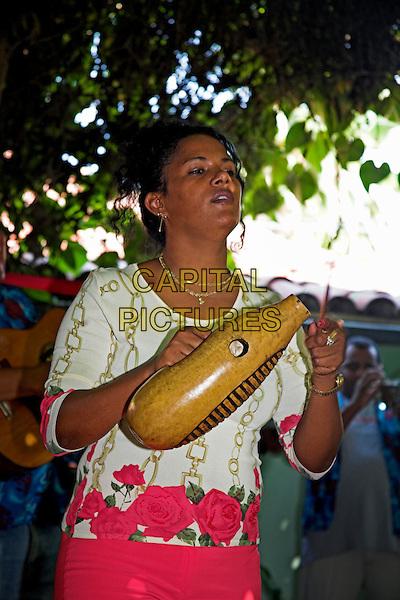 Lady singing and playing huiro, Casa de la Trova, location for traditional Cuban music, Bayamo, Granma Province, Cuba