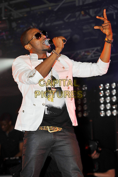 Dapo Daniel Oyebanjo aka D'banj .performing at the Barclaycard Wireless Festival, Hyde Park, London, England. 7th July 2012..music live gig on stage show half length   sunglasses jeans white jacket black t-shirt microphone singing hand waving .CAP/MAR.© Martin Harris/Capital Pictures.