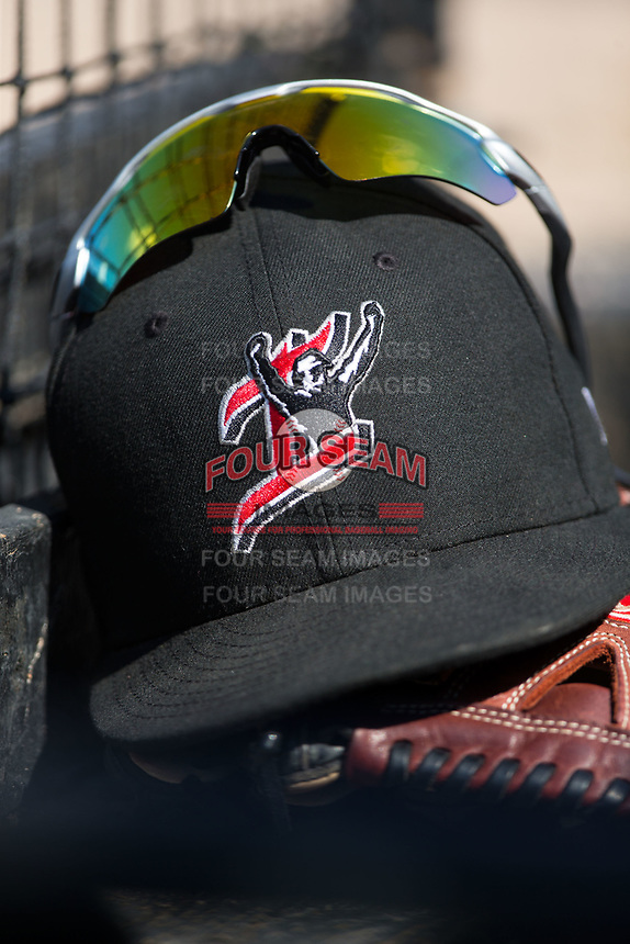 A Kannapolis Intimidators hat sits on top of a glove in the home dugout during the game against the Hagerstown Suns at Kannapolis Intimidators Stadium on June 15, 2017 in Kannapolis, North Carolina.  The Intimidators walked-off the Suns 5-4 in game one of a double-header.  (Brian Westerholt/Four Seam Images)