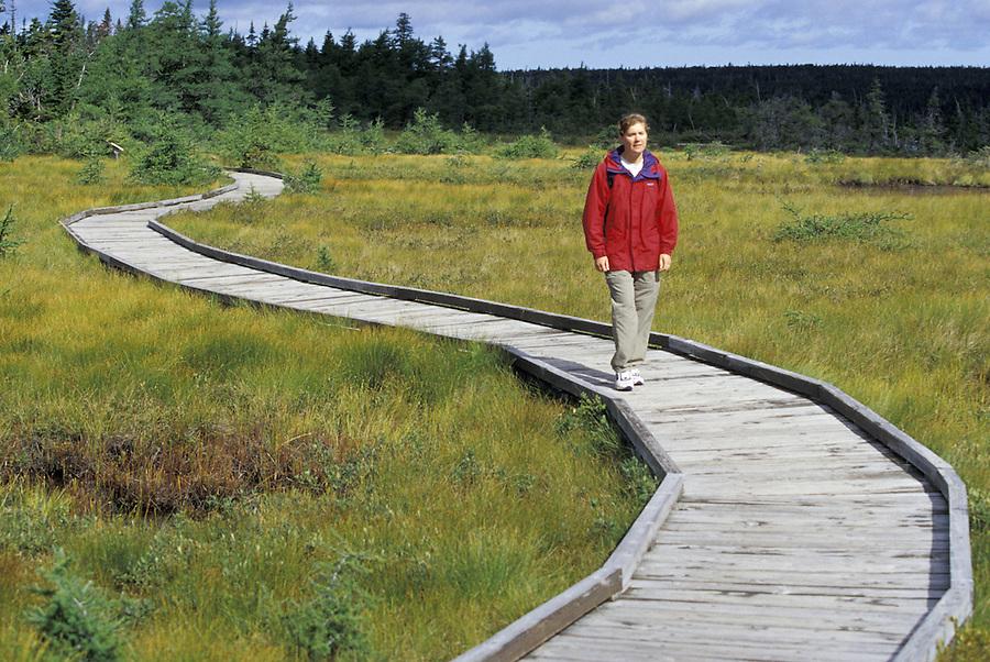 Woman hiking on boardwalk, Bog Lake Trail, Cape Breton National Park, Nova Scotia, Canada