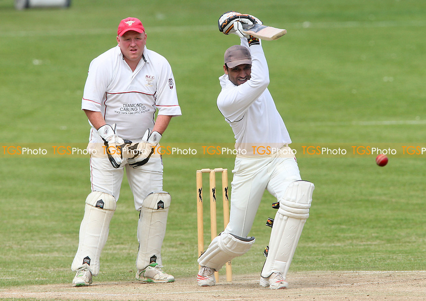 Abdul Rahman of Harold Wood in batting action and Hornchurch wicket keeper Paul Murray   - Harold Wood Cricket Club vs Hornchurch Cricket Club at Harold Wood 10/05/09 - MANDATORY CREDIT: Rob Newell/TGSPHOTO - IMAGES USED WILL BE INVOICED AT STANDARD RATES. Gavin Ellis/TGSPHOTO, 27 Plaiters Way, Braintree, Essex CM7 3LR - Tel: 0845 0946026 - BACS details for payment: Gavin Ellis - A/C 31840312 Sort Code 40-17-08. NO UNPAID USE..