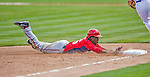 23 February 2013: Washington Nationals outfielder Eury Perez dives safely to third during Spring Training action against the New York Mets at Tradition Field in Port St. Lucie, Florida. The Mets defeated the Nationals 5-3 in their Grapefruit League Opening Day game. Mandatory Credit: Ed Wolfstein Photo *** RAW (NEF) Image File Available ***