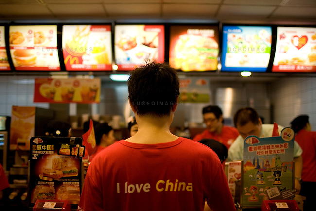 A man orders food from McDonald's, one of the official sponsors of the Games, in Beijing, China on Sunday, August 10, 2008.  Kevin German