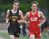 Brendan Dearie of St. Anthony's, left, paces alongside Aidan Healy of St. John the Baptist in the boys 3,200 meter run during the Nassau-Suffolk CHSAA track and field league championships at St. Anthony's High School on Saturday, May 20, 2017. Dearie won the event with a time of 9:47.51 while Healy took second at 9:53.81