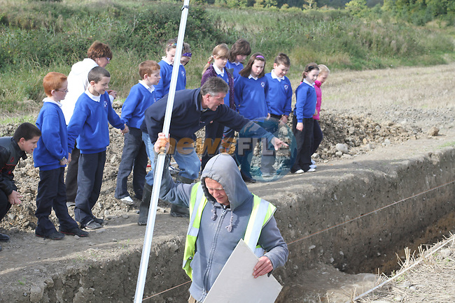 Brian Rogers, Chairperson of the Annagassan and District Historical Society with students from Dillonstown NS at the Site where archaeologists believe they have found the remains of a huge Viking fortress near the village of Annagassan in Co Louth...Picture Jenny Matthews/Newsfile.ie