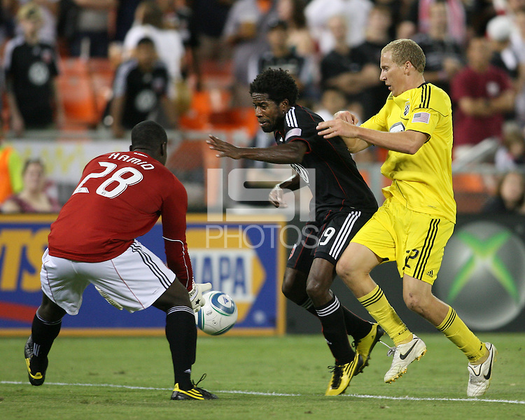 Bill Hamid #28 and Clyde Simms #19 of D.C. United keep the ball from Steven Lenhart #32 of the Columbus Crew during an MLS match at RFK Stadium on September 4 2010, in Washington DC. Columbus won 1-0.