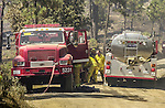 August 22, 2001 Coulterville, California  -- Creek Fire –  Fire crews working mop-up on Cuneo Road. The Creek Fire burned 11,500 acres between Highway 49 and Priest-Coulterville Road a few miles north of Coulterville, California.