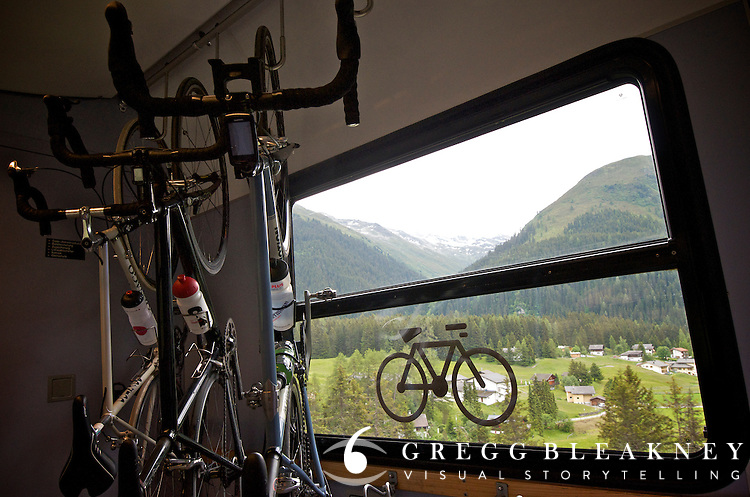Swiss trains not only allows bicycles, each has a special bike parking zone for cyclists.  These steeds are hanging in the Unesco World Heritage Train en route to Davos--the base of stage 7's climb up 2383m Fluelapass.