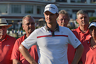 Bethesda, MD - June 29, 2014: Justin Rose (c) listens to other speakers before accepting the trophy for winning the Quicken Loans National at Congressional Country Club in Bethesda, MD, June 29, 2014. Rose won the tournament after a playoff with Shawn Stefani.  (Photo by Don Baxter/Media Images International)