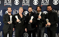 LAS VEGAS, NEVADA - APRIL 07: Group of the Year award winners Old Dominion pose in the press room during the 54th Academy Of Country Music Awards at MGM Grand Hotel &amp; Casino on April 07, 2019 in Las Vegas, Nevada. <br /> CAP/MPIIS<br /> &copy;MPIIS/Capital Pictures