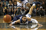 Nevada forward Cody Martin (11) dives for a loose ball against Akron in the first half of an NCAA college basketball game in Reno, Nev., Saturday, Dec. 22, 2018. (AP Photo/Tom R. Smedes)