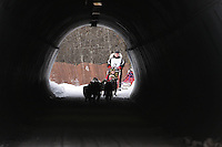 Saturday March 6 , 2010  Karen Ramstead runs through a culvert underneath Gambell street in  mid-town Anchorage during the ceremonial start of the 2010 Iditarod in Anchorage , Alaska