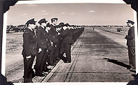 BNPS.co.uk (01202 558833)<br />Pic: C&T/BNPS<br /><br />Flt Lt Antoni Lipkowski receiving a medal on an unknown airfield in Europe.<br /> <br /> A fascinating photo album has sold for £1200 at auction - the previously unseen photographs chart the wartime career of Polish aristocrat Antoni Lipkowski -revealing how the emigree from Nazi Europe became a fighter pilot in the RAF.<br /> <br /> Flight Lieutenant Antoni Lipkowski escaped Poland when Germany invaded in 1939 and was desperate to join in the fight against the Nazis.<br /> <br /> Previously a cavalry officer, he retrained as a pilot and joined one of the Polish squadrons based in Britain which did such sterling work defending these skies in World War Two.<br /> <br /> Flt Lt Lipkowski, of 316 Polish Fighter Squadron, was very tall for a pilot and turned heads with his 'handsome' appearance.<br /> <br /> There are images of him in the cockpit of his Spitfire and posing nonchalantly in front of it with a cigarette in his hand.