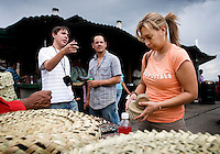 Tourists look through Tarahumara baskets and other souvenirs in front of the Chihuahua Pacifico train at Divisidero in Copper Canyon, Mexico, Saturday, June 21, 2008. The Tarahumara people are indigenous to North Mexico and moved into Copper Canyon after the Spanish came into the country....PHOTOS/ MATT NAGER