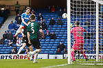 Jon Daly tests the keeper with a first half header