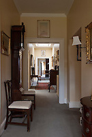 A long corridor, cut by a series of white-painted door frames, creates an enfilade on an upstairs landing