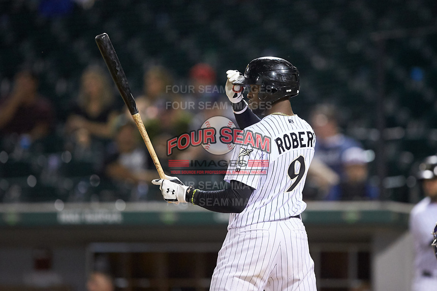 Luis Robert (9) of the Charlotte Knights at bat against the Durham Bulls at BB&T BallPark on July 31, 2019 in Charlotte, North Carolina. The Knights defeated the Bulls 9-6. (Brian Westerholt/Four Seam Images)