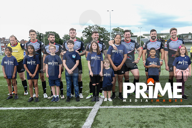 Players with mascots ahead of the Kingstone Press Championship match between London Broncos and Featherstone Rovers at Castle Bar , West Ealing , England  on 25 June 2017. Photo by David Horn.