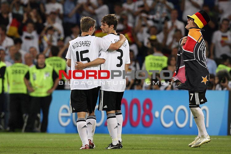 UEFA Euro 2008 Semi-Finals Match 29 Basel - St. Jakob-Park. Deutschland ( GER ) - T&uuml;rkei ( TUR ) 3:2 ( 1:1 ). <br /> Thomas Hitzlsperger ( Germany / Mittelfeldspieler / Midfielder / VfB Stuttgart #15 ) und Arne Friedrich ( Germany / Verteidiger / Defender / Hertha #03 ) und Bastian Schweinsteiger ( Germany / Mittelfeldspieler / Midfielder / Bayern Muenchen #07 ) (l-r) freuen sich nach dem Sieg mit Deutschlandflagge und Hut.<br /> Foto &copy; nph (  nordphoto  )