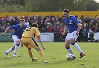 Lee Wallace being closely watched by Ryan McIntosh as Robbie Crawford waits to get a pass in the Forres Mechanics v Rangers William Hill Scottish Cup 2nd Round match, at Mosset Park, Forres on 29.9.12.