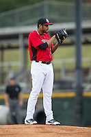 Hickory Crawdads starting pitcher Pedro Payano (17) looks to his catcher for the sign against the Charleston RiverDogs at L.P. Frans Stadium on August 25, 2015 in Hickory, North Carolina.  The Crawdads defeated the RiverDogs 7-4.  (Brian Westerholt/Four Seam Images)