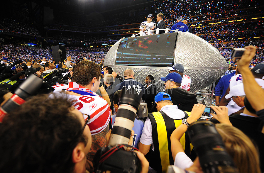 Feb 5, 2012; Indianapolis, IN, USA; New York Giants quarterback Eli Manning holds the Vince Lombardi trophy as he talks with television personality Dan Patrick after the Giants defeated the New England Patriots 21-17 in Super Bowl XLVI at Lucas Oil Stadium.  Mandatory Credit: Mark J. Rebilas-...