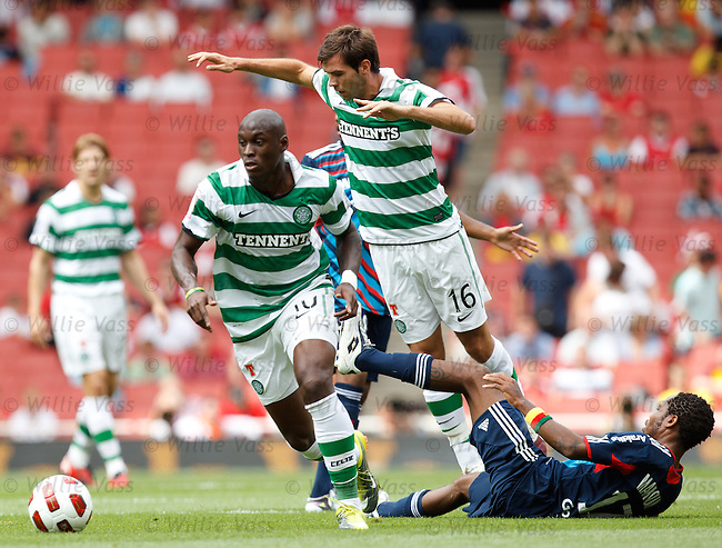 Marc Antione Fortune and Joe Ledley break free from the tackle of Jean Makoun