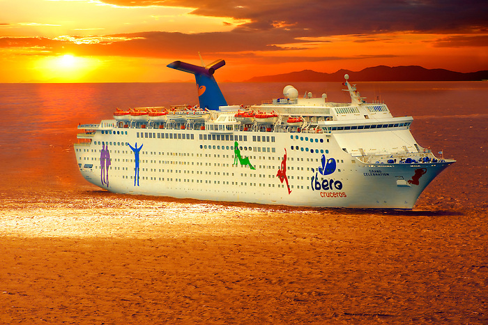 The Iberos Cruise lines Grand Celebration off Mykonos at sunset, Cyclades Islads, Greece