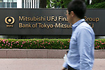 A man walks past a signboard of Bank of Tokyo-Mitsubishi UFJ on display outside its building on May 17, 2017, Tokyo, Japan. Japan's biggest bank plans to shorten its name by dropping ''Tokyo'' to Bank of Mitsubishi UFJ. (Photo by Rodrigo Reyes Marin/AFLO)
