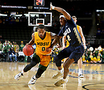 SIOUX FALLS, SD - MARCH 8: Vinnie Shahid #0 of the North Dakota State Bison drives against Deondre Burns #2 of the Oral Roberts Golden Eagles at the 2020 Summit League Basketball Championship in Sioux Falls, SD. (Photo by Dave Eggen/Inertia)